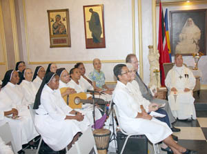 Dominican Sisters of St Catherine of Siena listen attentively during last Sunday's Ceremony of Transfer of their Mother House.The main chapel at the new Mother House in Barataria, is adorned with objects that came from the former Mother House in Etrépagny, France. Abbot John Pereira, OSB sits under a painting of the Congregation's Foundress Mother St Dominic of the Cross. Also in the photo, front row left: Regional Prioress Sr Thérèse Antoine, Prioress General Sr Jeannette Léger and French Consul Joel Ferrand. Desmond Durham photo.